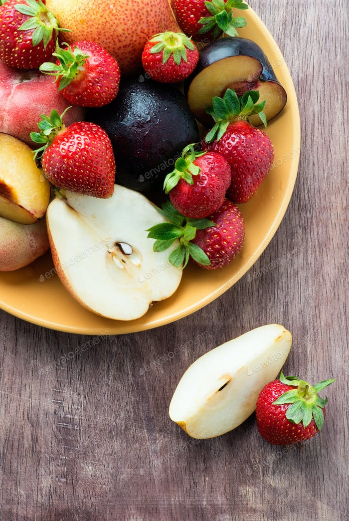Fresh summer fruits in plate