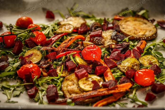 Roasted vegetables with fresh rocket