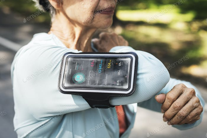 Senior runner using a fitness tracker