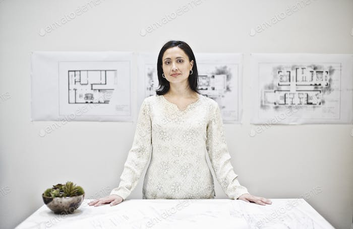 Hispanic woman in an architect's office.
