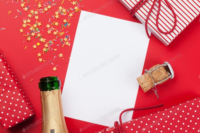 Champagne, blank card and gift boxes