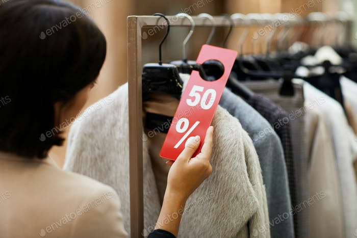 Customer Choosing Clothes on Sale