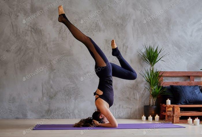 Female doing yoga Pilates.