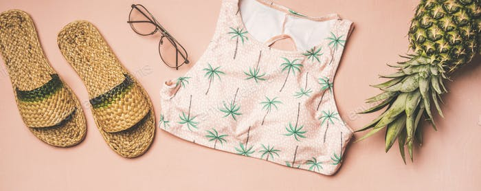 Variety of summer apparel fashionable items and pinapple, wide composition