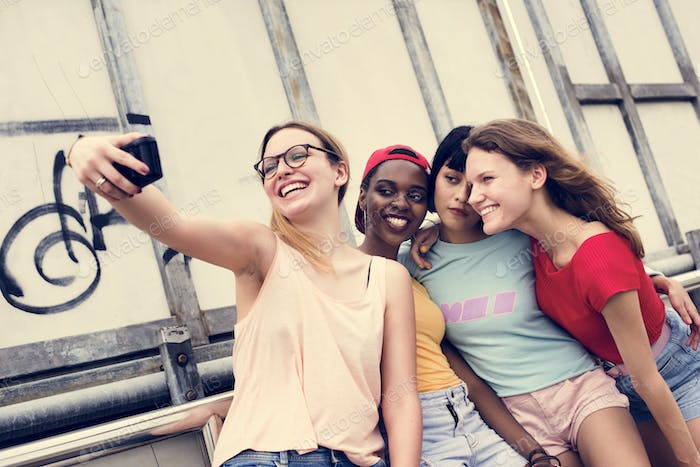 Group of diverse women taking selfie together