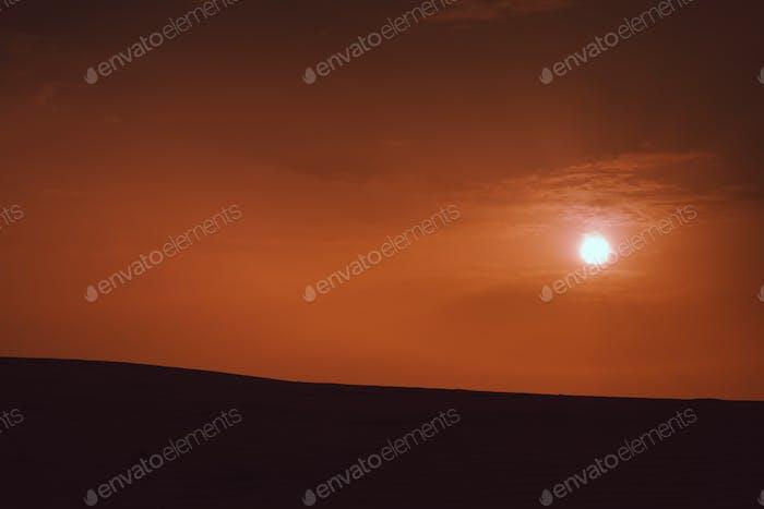 Sunset over sanddunes