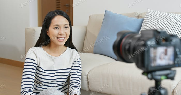 Woman sit in front of camera and talk