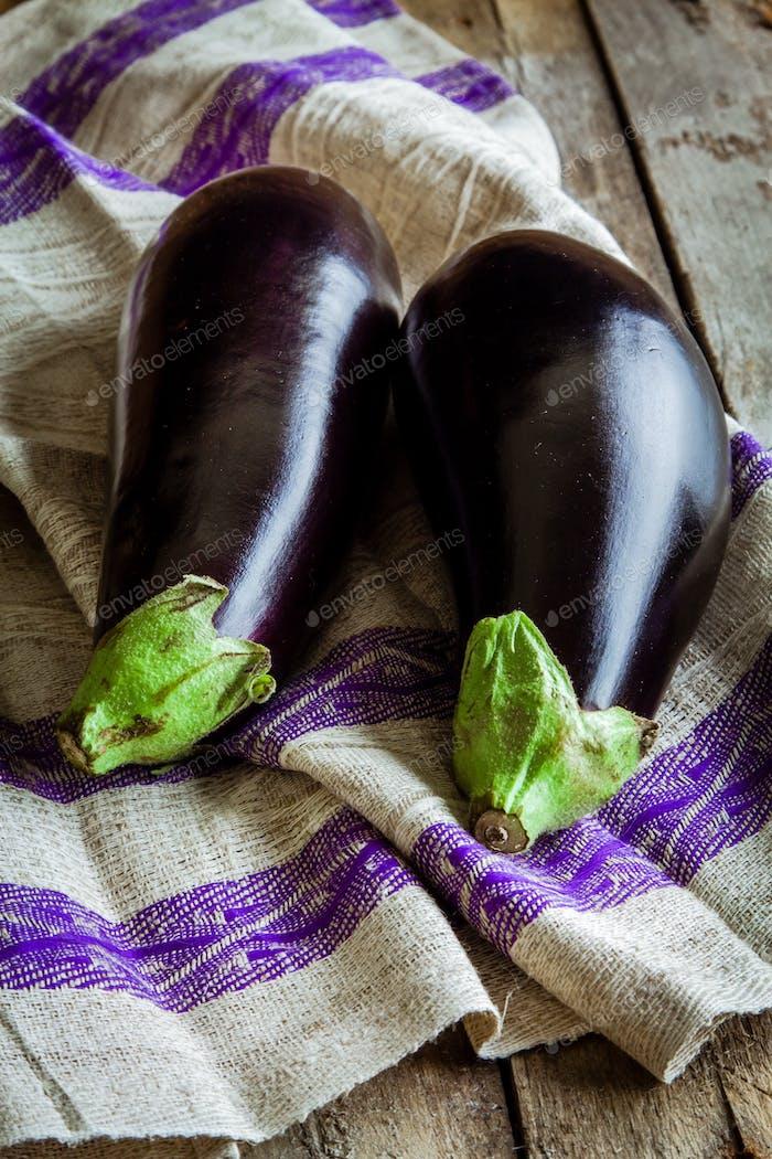 two raw organic eggplant