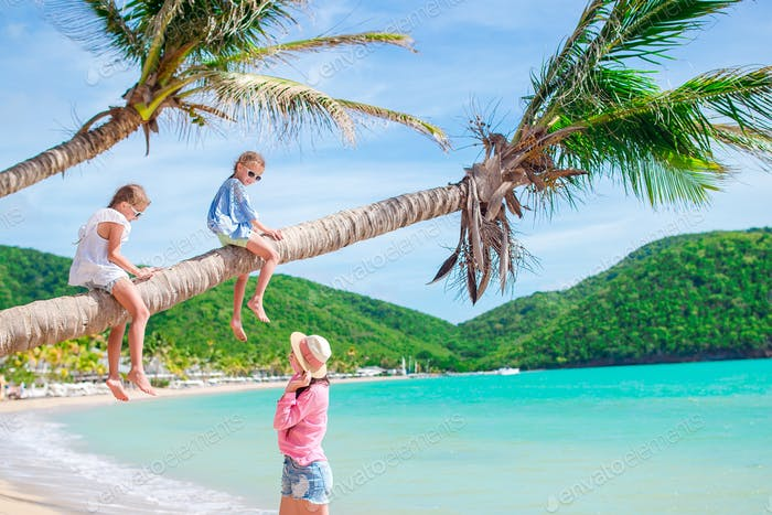 Young family on vacation have a lot of fun on palmtree
