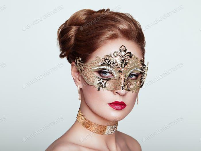 Beautiful woman in venetian masquerade mask