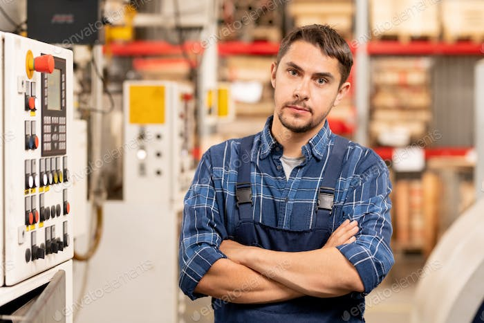 Young professional technician or engineer of large processing factory