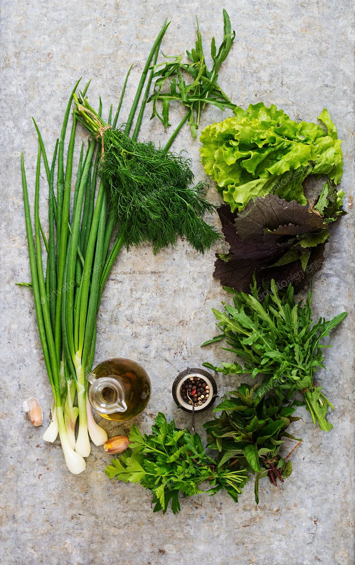 Variety fresh organic herbs  on grey background in rustic style. Top view