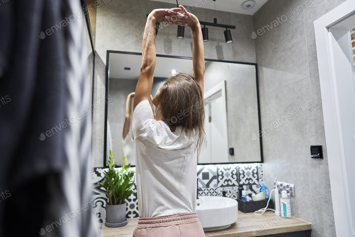 Morning stretching in the bathroom