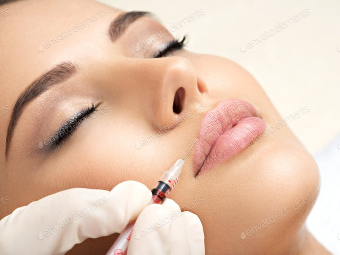 woman gets botox injection in her face