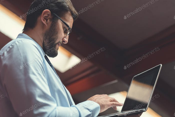 Young businessman with laptop