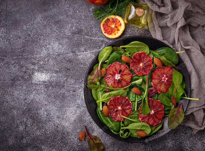 Healthy salad with spinach and bloody oranges