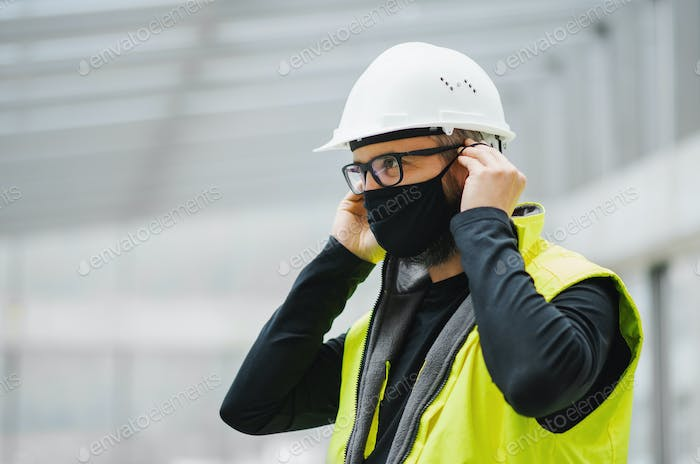 Portrait of worker with face mask at the airport