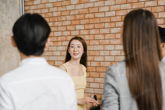Asia businessmen and businesswomen meeting brainstorming ideas.