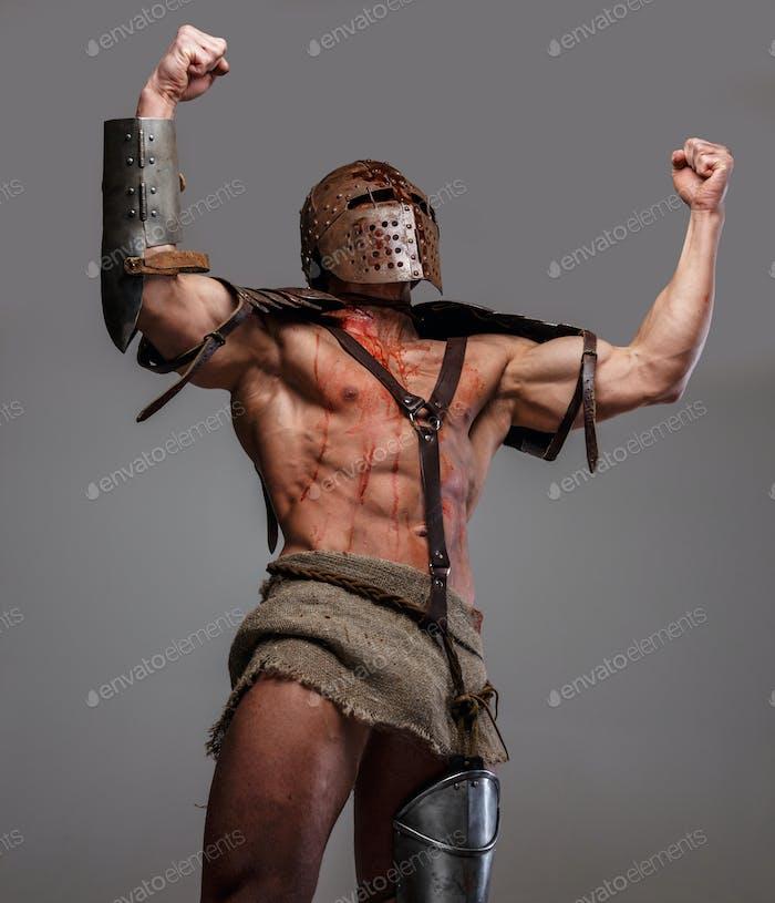 Agressive bloody gladiator.