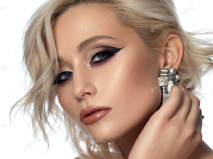 Portrait of beautiful woman with fashion make up