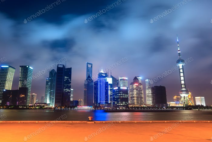 shanghai skyline with pier at night
