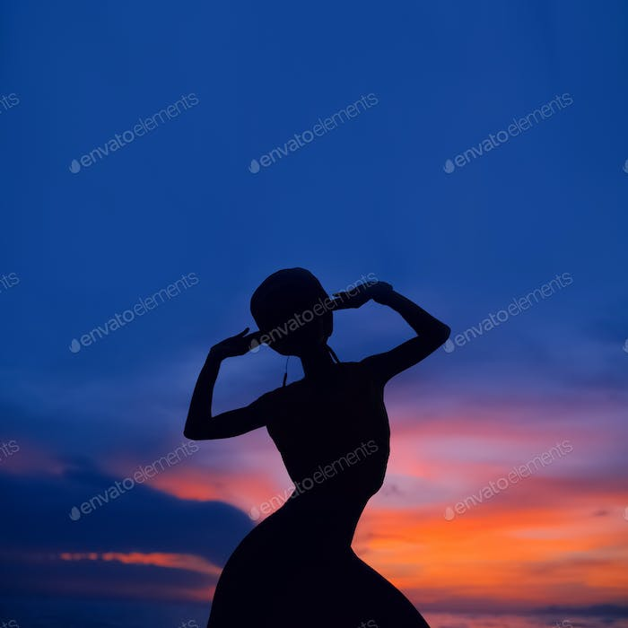 dancing girl at sunset