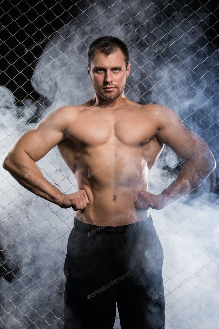 Fitness. Beautiful, strong man and his muscles