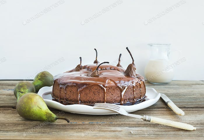 Pear, ginger and honey cake with creamy caramel topping, fresh p