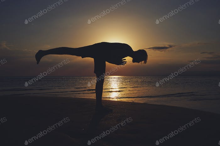 Man practicing yoga in various poses (asana)
