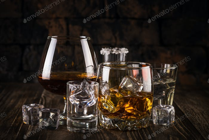 Strong alcohol drinks - whiskey, cognac, vodka, rum, tequila
