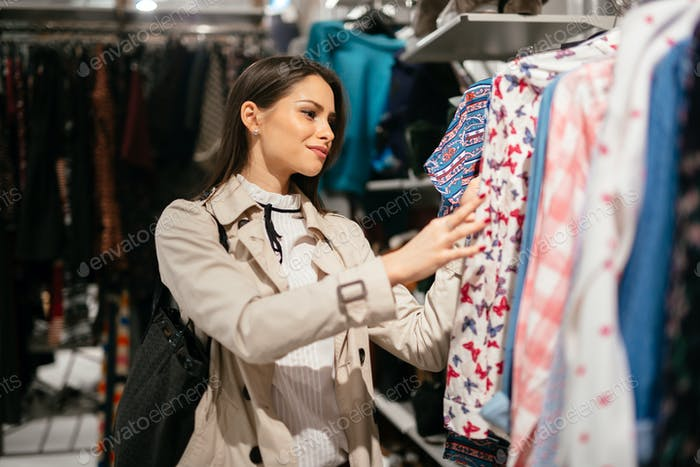 Beautiful brunette buying clothes