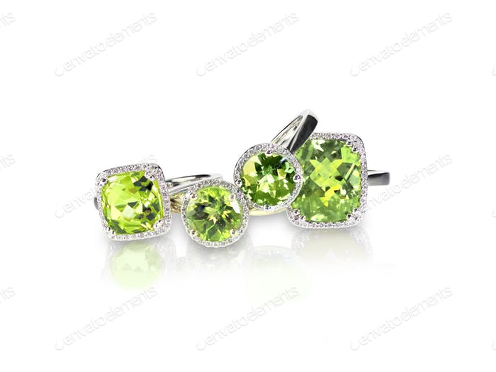 Set of green peridot diamond rings gemstone fine jewelry. Group stack