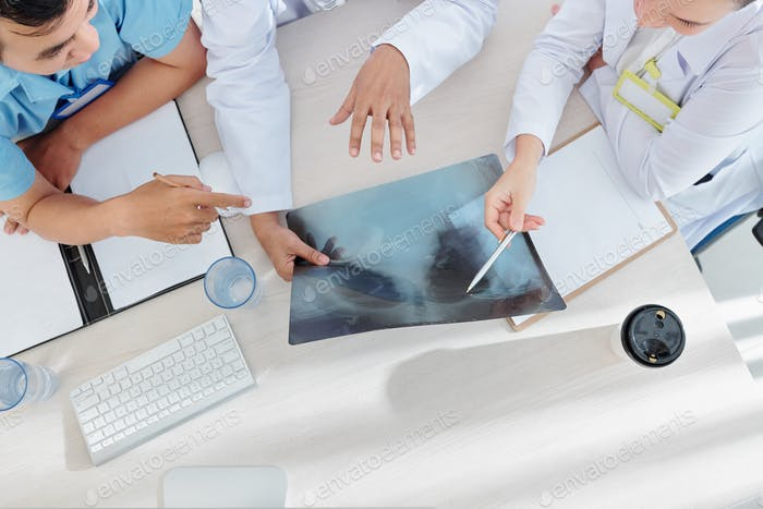 Medical workers discussing disease