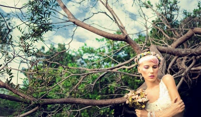 .Portrait of romantic girl in the woods