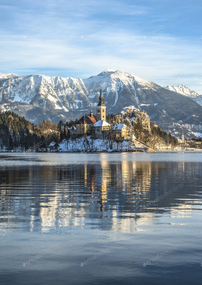 Bled on a beautiful winter morning. Sunrise over the church on the island