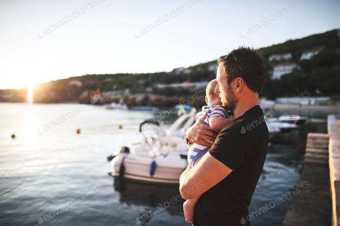 Man with baby son enjoying their time at seaside.