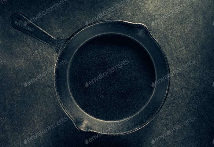 frying pan and napkin on black