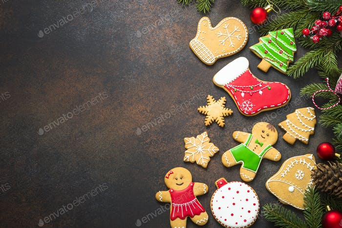 Christmas gingerbread with christmas decorations on dark  backg