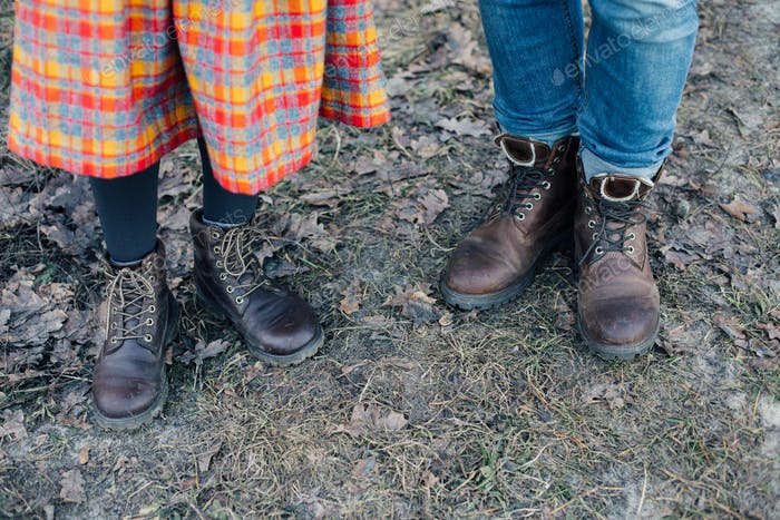 Man and woman in leather heavy duty boots