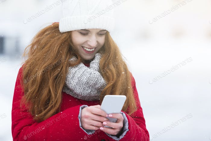 Cheerful young woman chatting with friends while walking