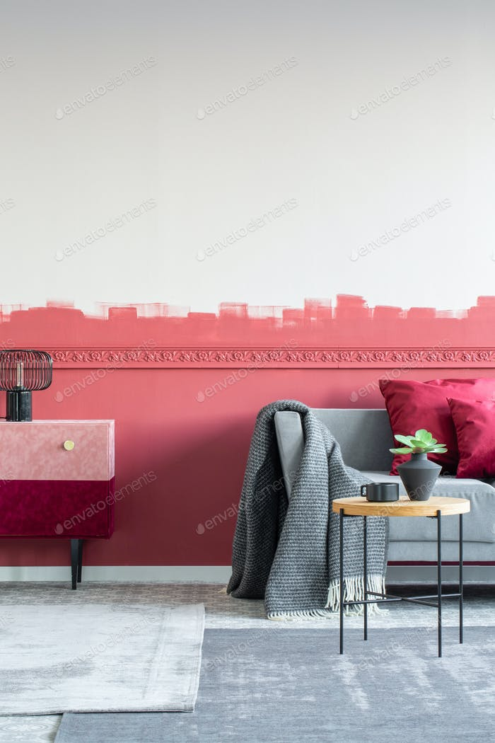 Modern living room interior with burgundy and white ombre wall