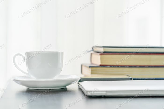 Coffee cup and book on table-2