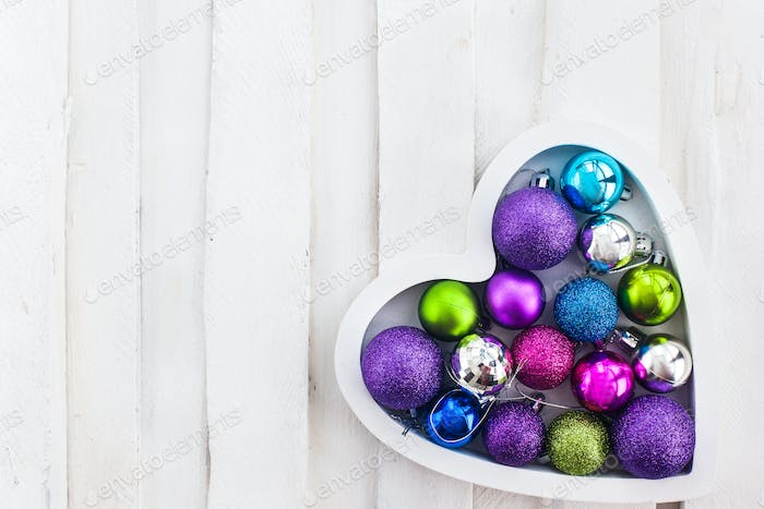 Сhristmas card with wooden heart, balls, decoration