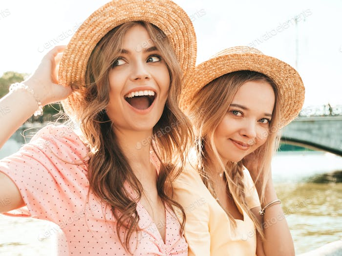 Portrait of two young funny women posing outdoors