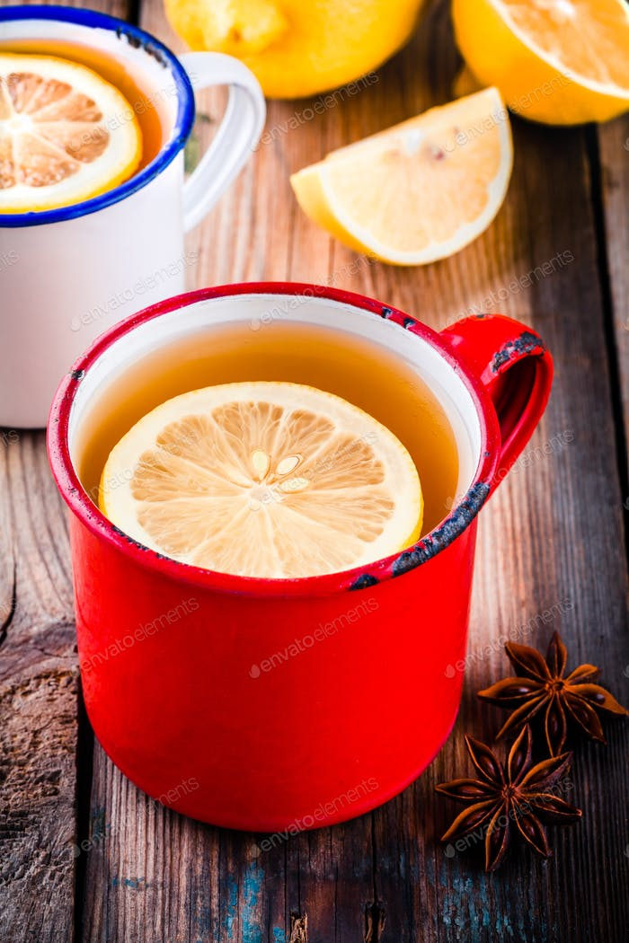 Hot tea with lemon in a rustic mug