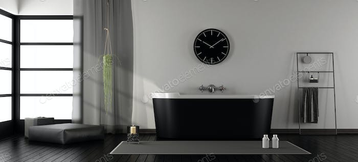 Modern bathroom with black bathtub