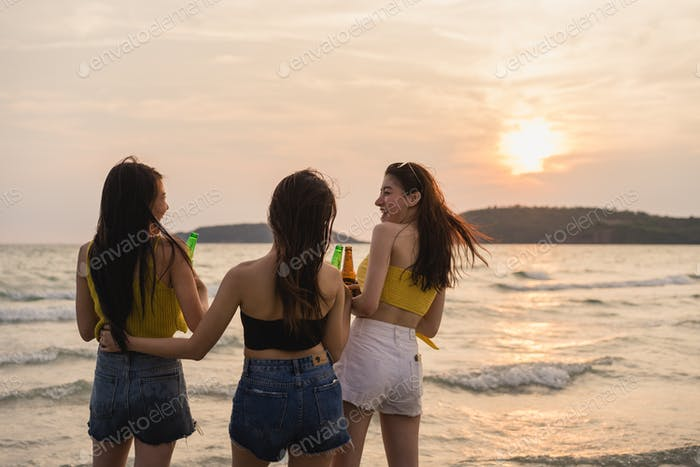 Asian teenage girls having party celebrating on beach, friends happy drinking beer on beach.