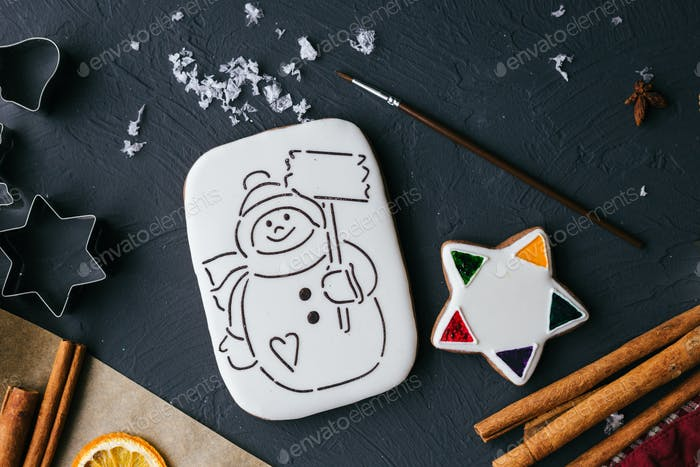 Christmas gingerbread cookie with icing and a painted snowman to be painted top view.