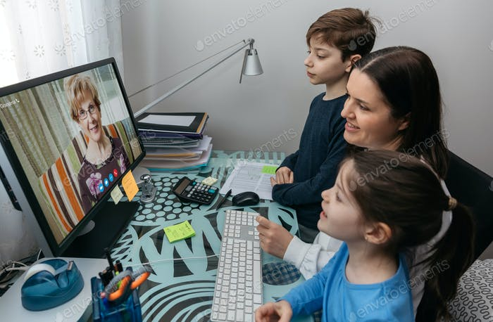 Family talking on video call with grandmother