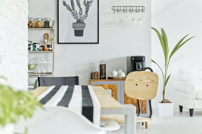 White interior with wooden table